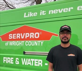 Man standing by SERVPRO Vehicle